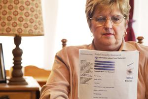 Senior woman reading Social Security form.