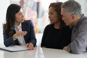 Ethnic Senior Couple With Financial Advisor