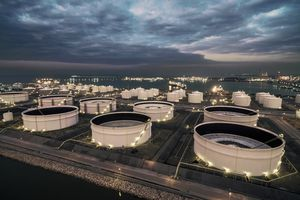 oil storage tank in oil refinery near the sea at night, Rayong, thailand.