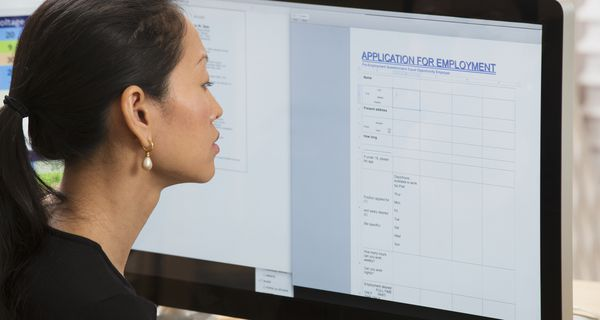 Young woman looking at employment application online
