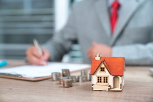 Businessman as a property agent or investor calculating return on investment from real estate