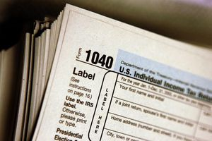 A stack of IRS Form 1040s