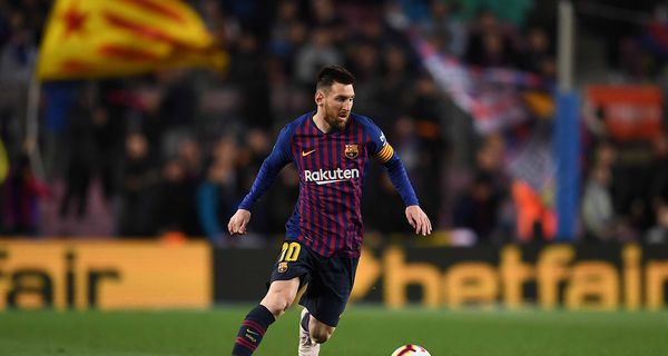 Lionel Messi of FC Barcelona runs with the ball during the La Liga match between FC Barcelona and Real Sociedad at Camp Nou on April 20, 2019 in Barcelona, Spain.