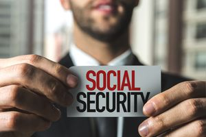A man holding a social security sign.