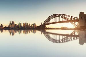 Panorama of Cityscape image of Sydney, Australia with Harbour Bridge and Sydney skyline during sunrise.