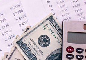 Cash, a calculator, and a balance sheet.