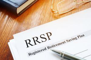RRSP Registered Retirement Saving Plan documents on table.